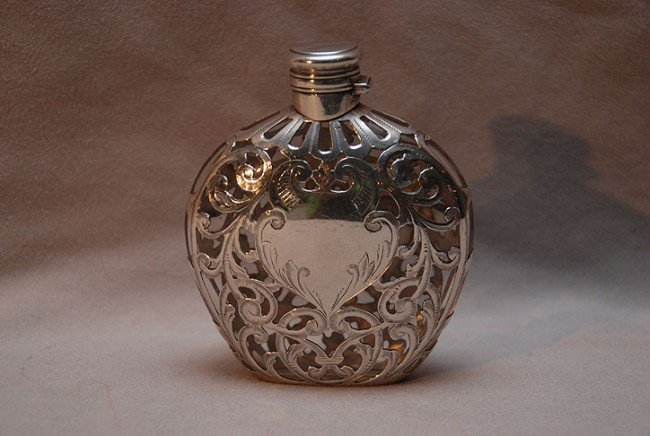 "15: Silver overlay perfume bottle with hinged top, 4""h"