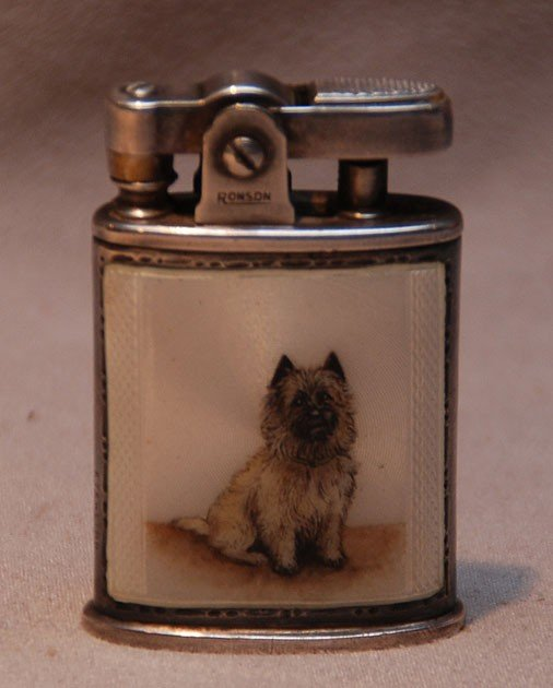 23: Silver plate Ronson lighter with enameling of dog o
