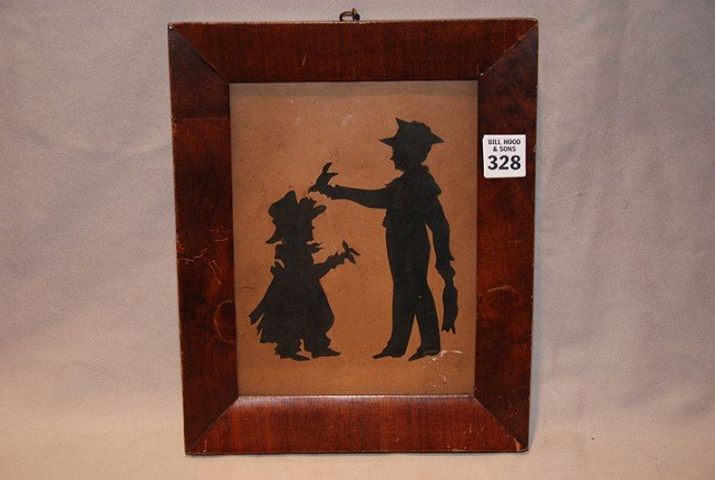 328: Framed silhouette of 2 children in frame, picture