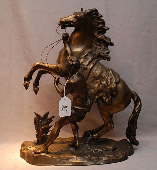 339: Gilt Metal (Marley) Sculpture,  trainer holding re