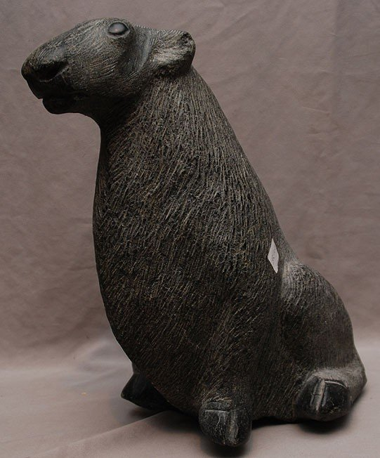 323A: Large Inuit carved artic musk rat, signature on