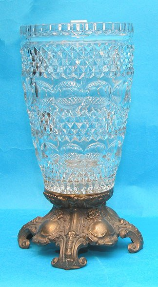 """1001: Glass vase 10""""h on 3"""" footed colored metal stand"""