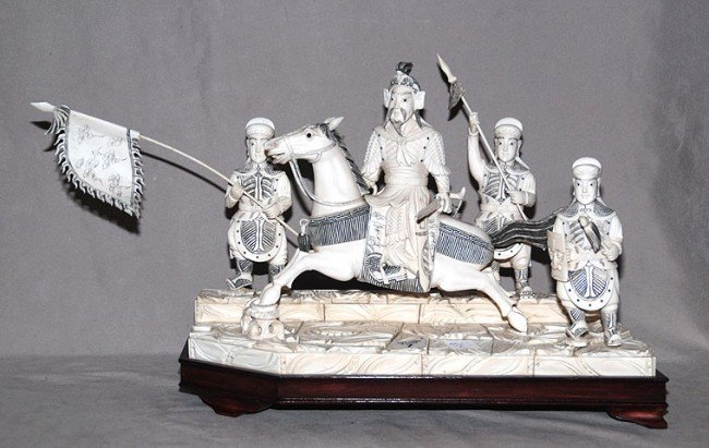 7: Large Chinese carved ivory Emperor on horseback and
