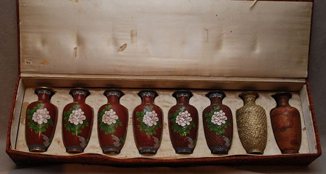 12: 8 vases in box showing stages of cloisonné make-up