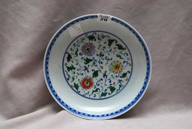 20: 19th c. Chinese bowl, blue rim and flowers in cente