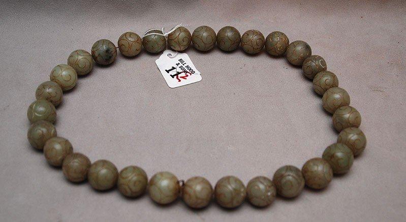 "11: Pair of carved jade beads, 9""L"