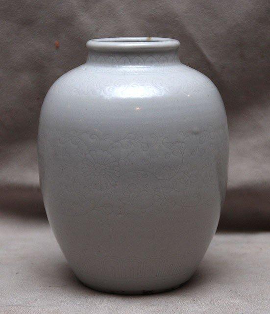 18: Antique Chinese white vase with flower design aroun