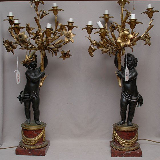 121: Pr. Of large figural bronze putti on rouge marble