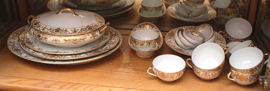 11: Noritake china set, white with gilded border