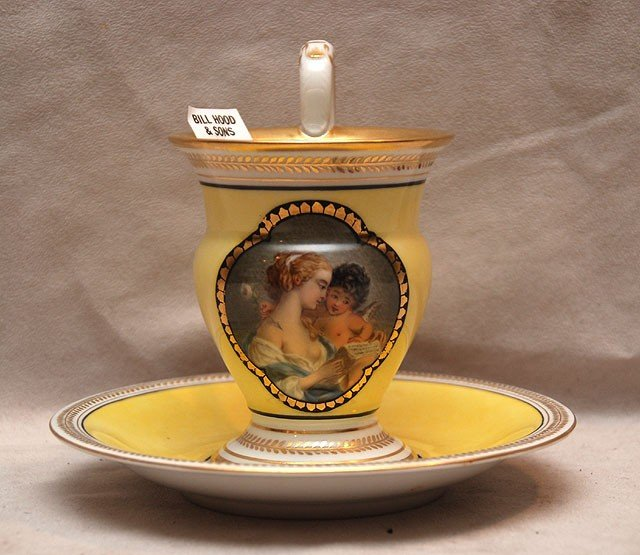 22: Porcelain cup and saucer, mother and child on yello