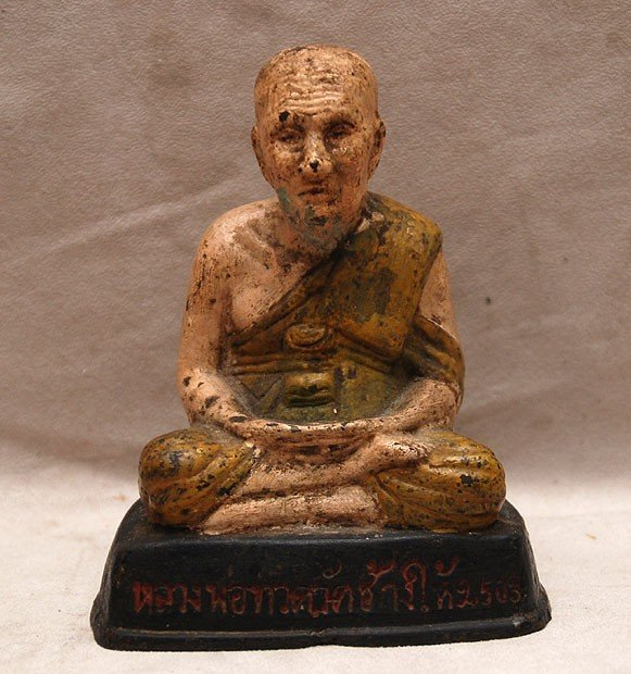 504: Asian painted bronze figure of a monk seated in lo