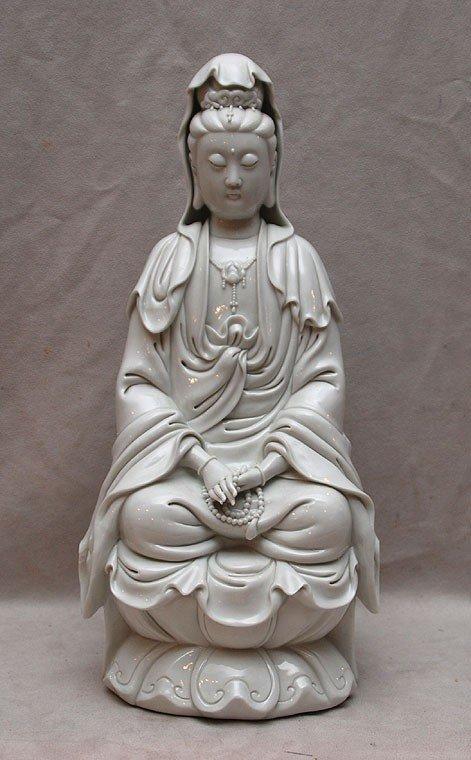 517: Blanc de Chine seated deity on lotus form base, st