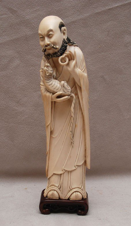 609: Chinese carved ivory old wise man holding tiger