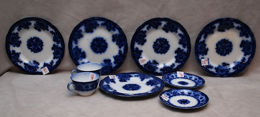 12: 9 Flow blue pieces; 2 cups, 2 saucers and 5 plates