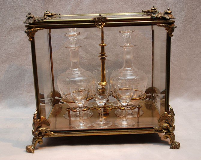 118: Antique brass and glass tantalus set incl: 2 decan