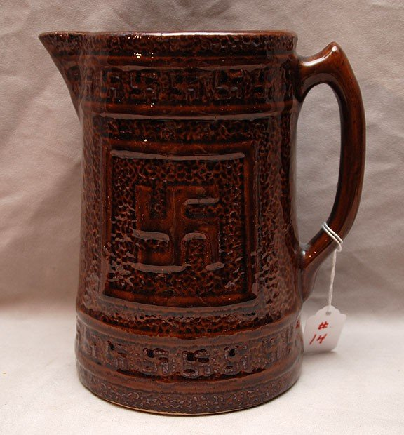 14: Pottery pitcher with Indian cross marking, brown gl