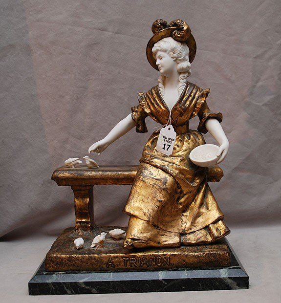 17: Gilded metal & bisque figure of seated elegant woma