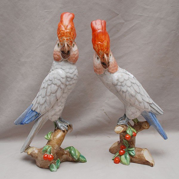 22: Pair of Italian figural parrots on branches, (chip