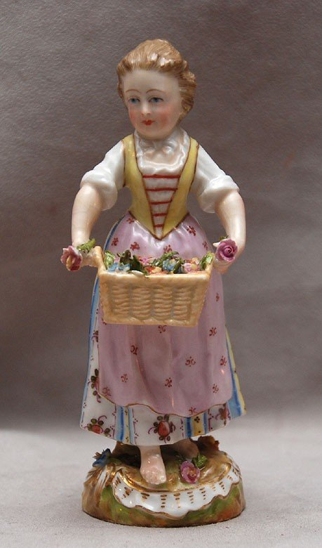 128: Porcelain girl carrying basket of roses, there is