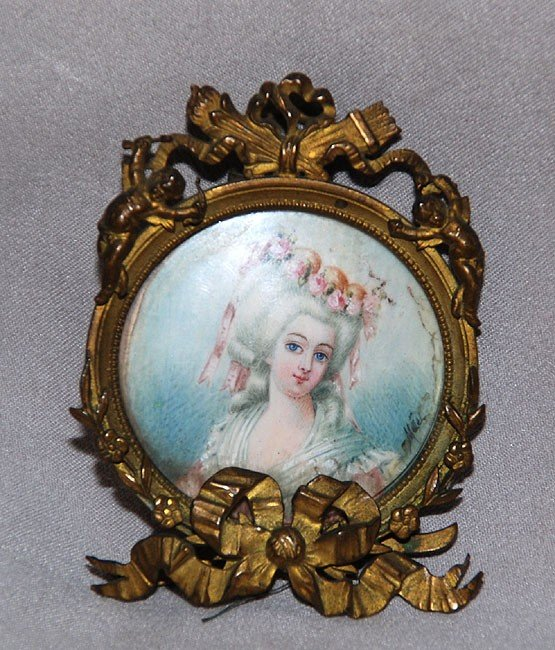 139: Miniature portrait on ivory in bronze frame, signe