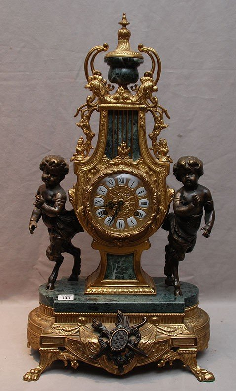 143: Bronze and marble French clock with puttis