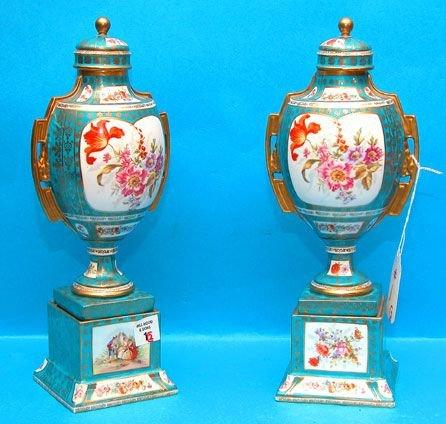 1001: Pair of covered porcelain urns, inside edge of li