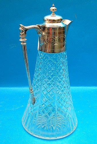 1013: Antique cut glass Claret jug w/ silver mounts,
