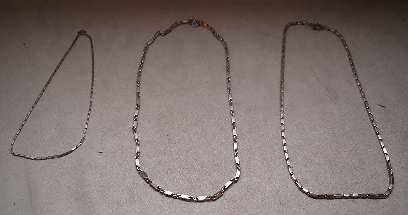 123: Lot of 3 sterling necklaces, one with interlocking