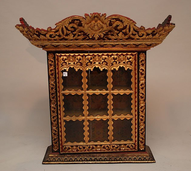 131: Asian carved & gilded hanging cabinet, 9 panes of