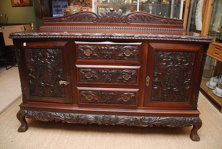 136: Heavily carved sideboard, 3 center drawers flanked