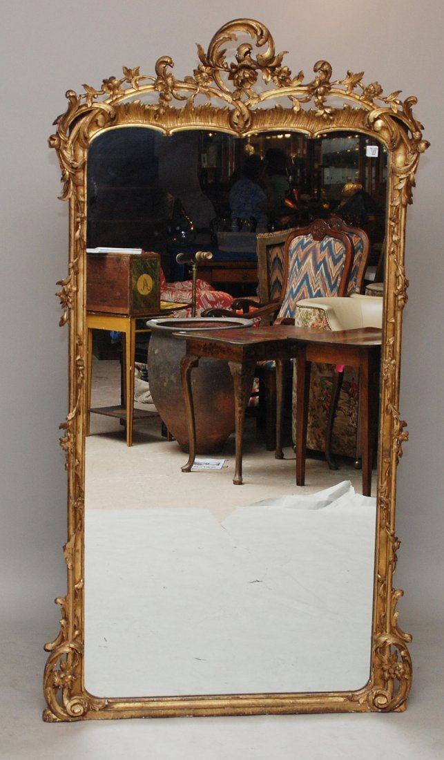 112: Outstanding gilded mirror with vining floral rococ