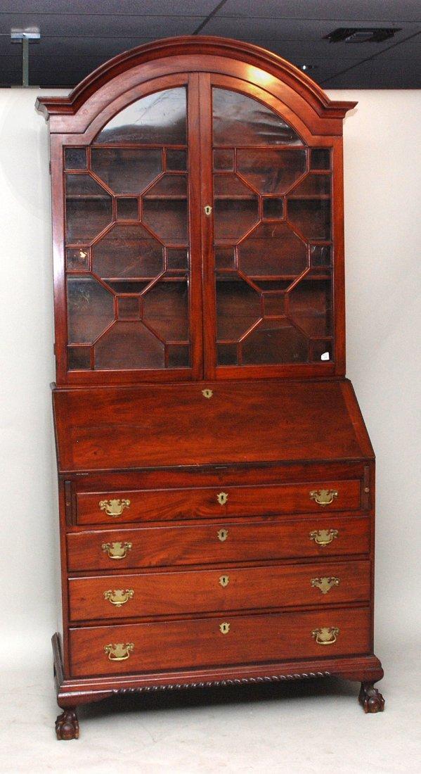 114: Mahogany secretaire/bookcase, 19th c, curved corni