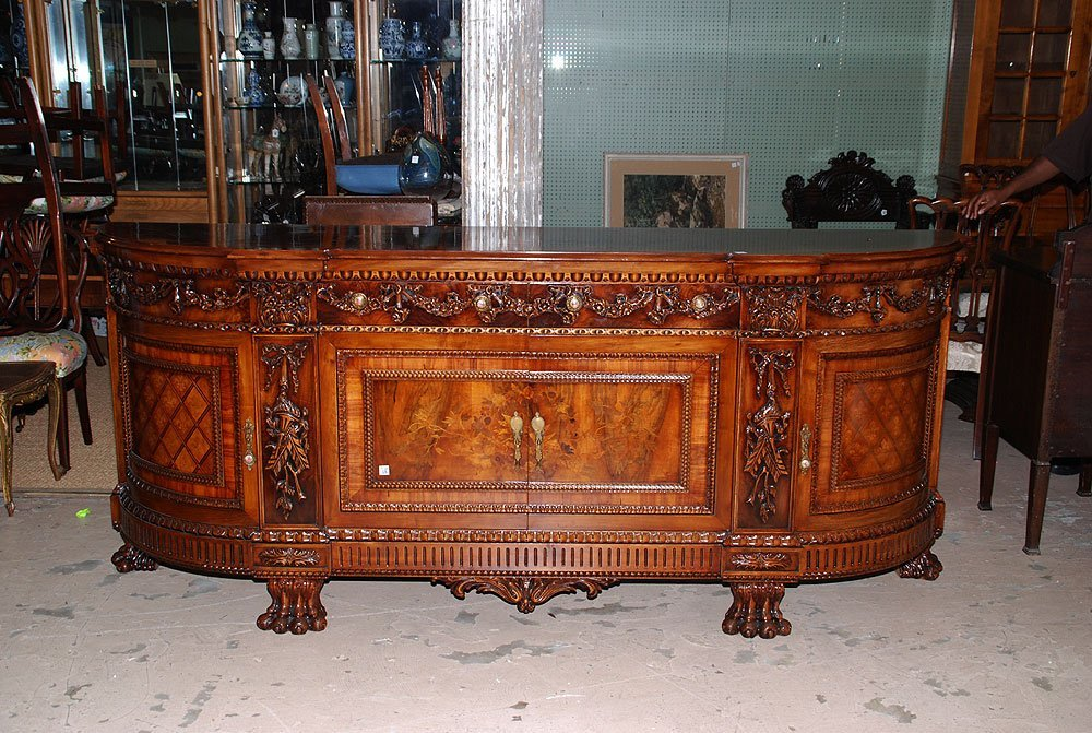 126: Ornately carved sideboard with parquetry type desi