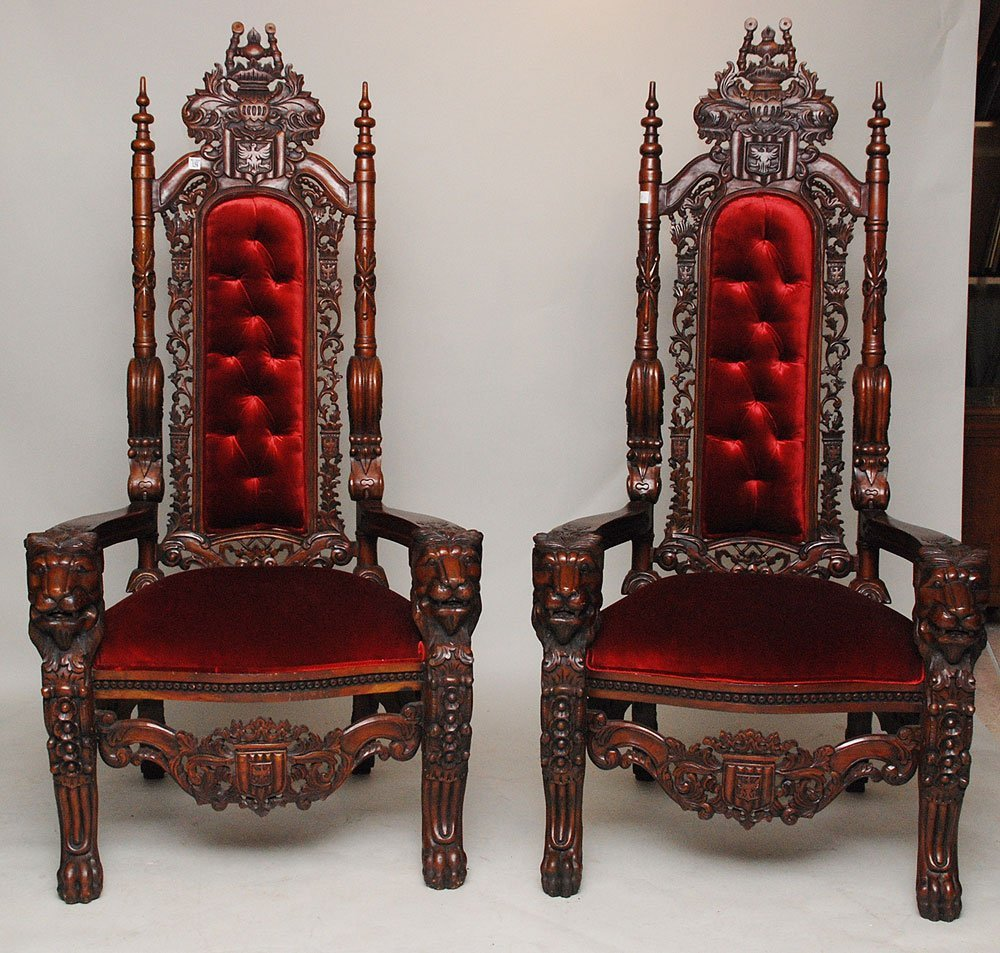 129: Pair throne chairs, heavily carved armorial motif,