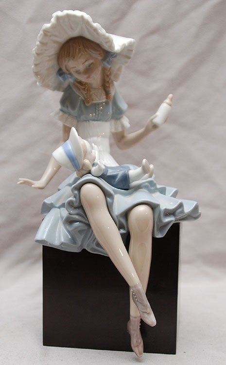 16: Lladro figure of girl with baby on her lap, attache