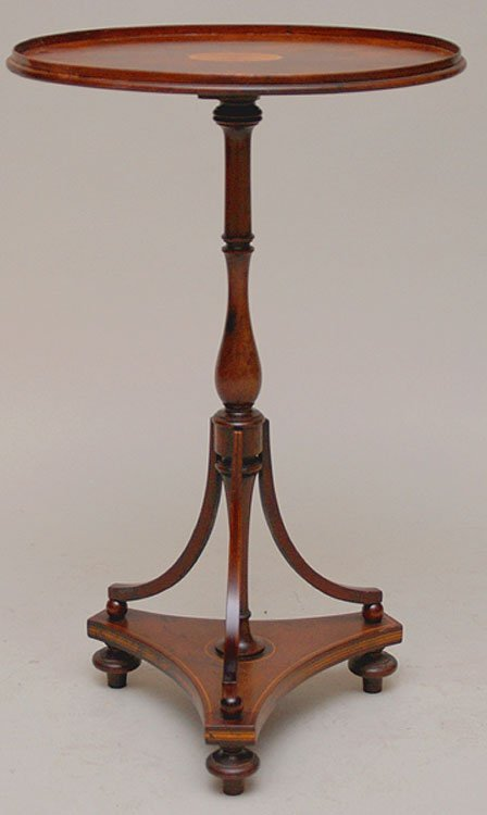 1: Oval mahogany occasional table on turned pedestal le