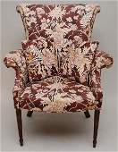 447: Floral upholstered arm chair with matching footsto