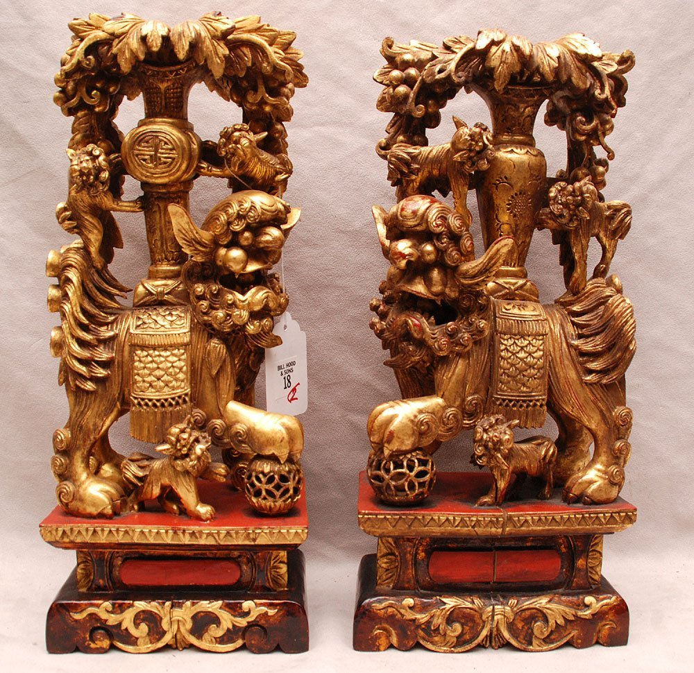 18: Pair of Chinese elaborate carved gilt wood Foo lion