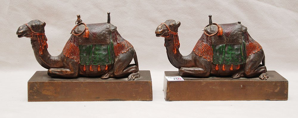 21: Pair of kneeling bronze camels with polychrome pain
