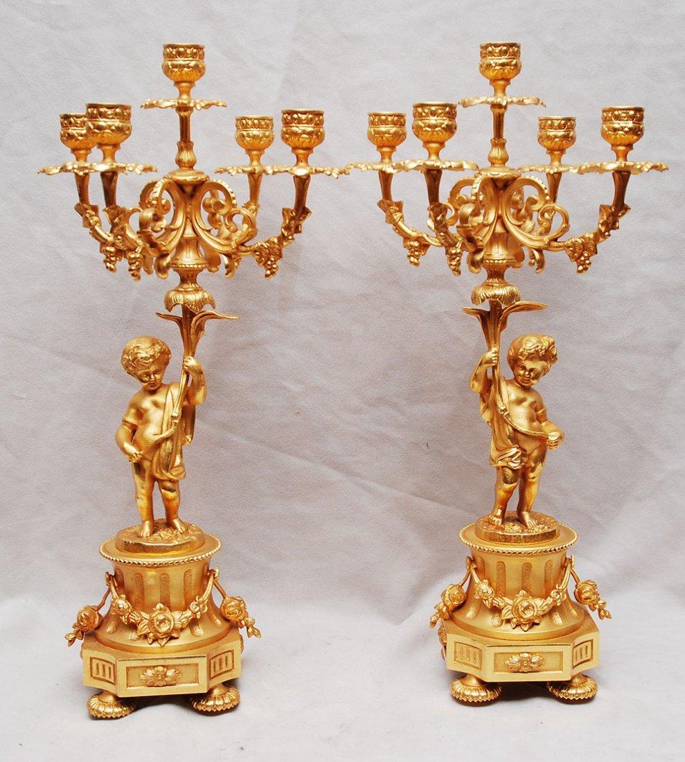 24: Pair of Italian bronze gilded 5 light candelabra