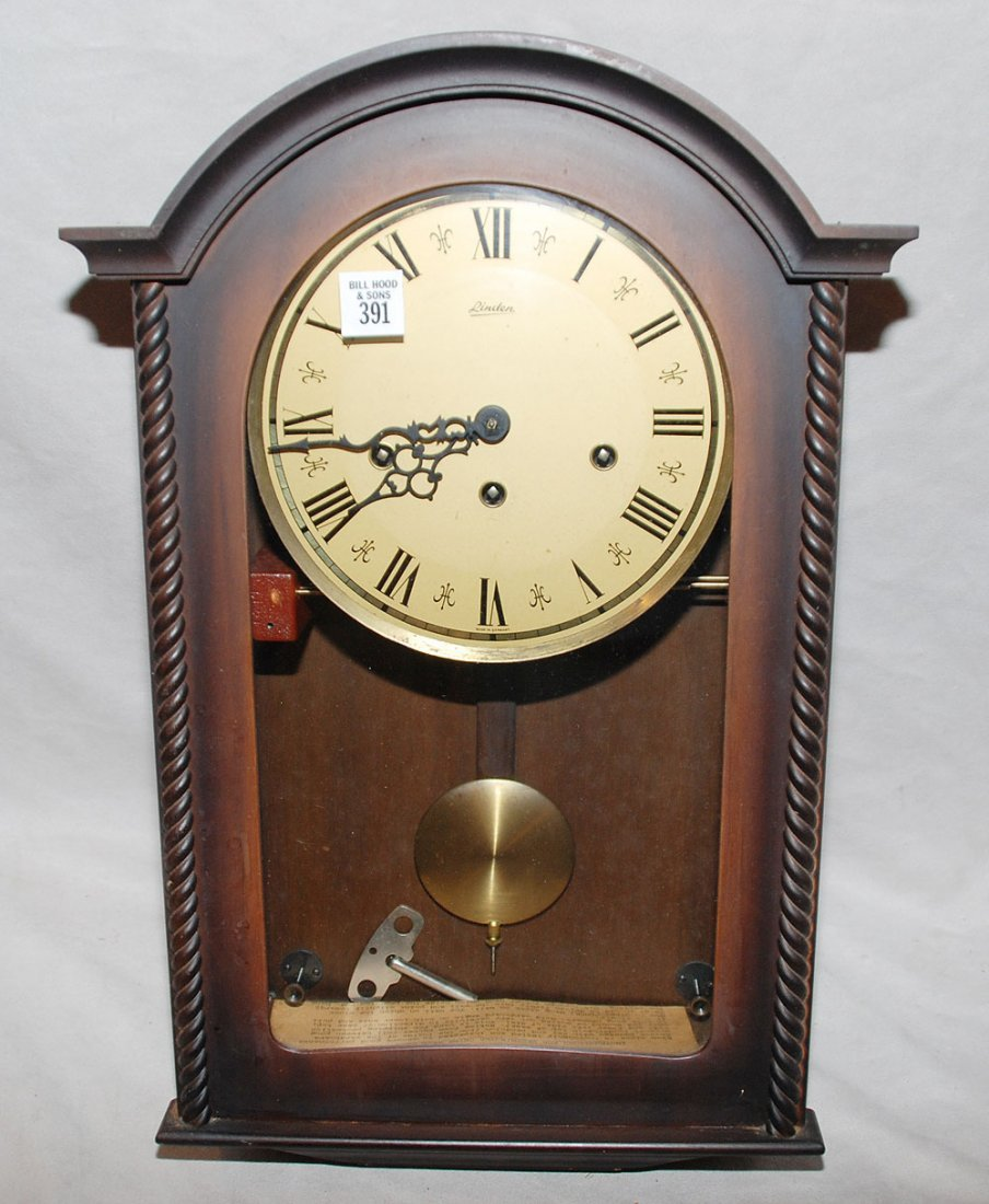 "391: Linden wood wall clock, Westminster chimes, 18""h"
