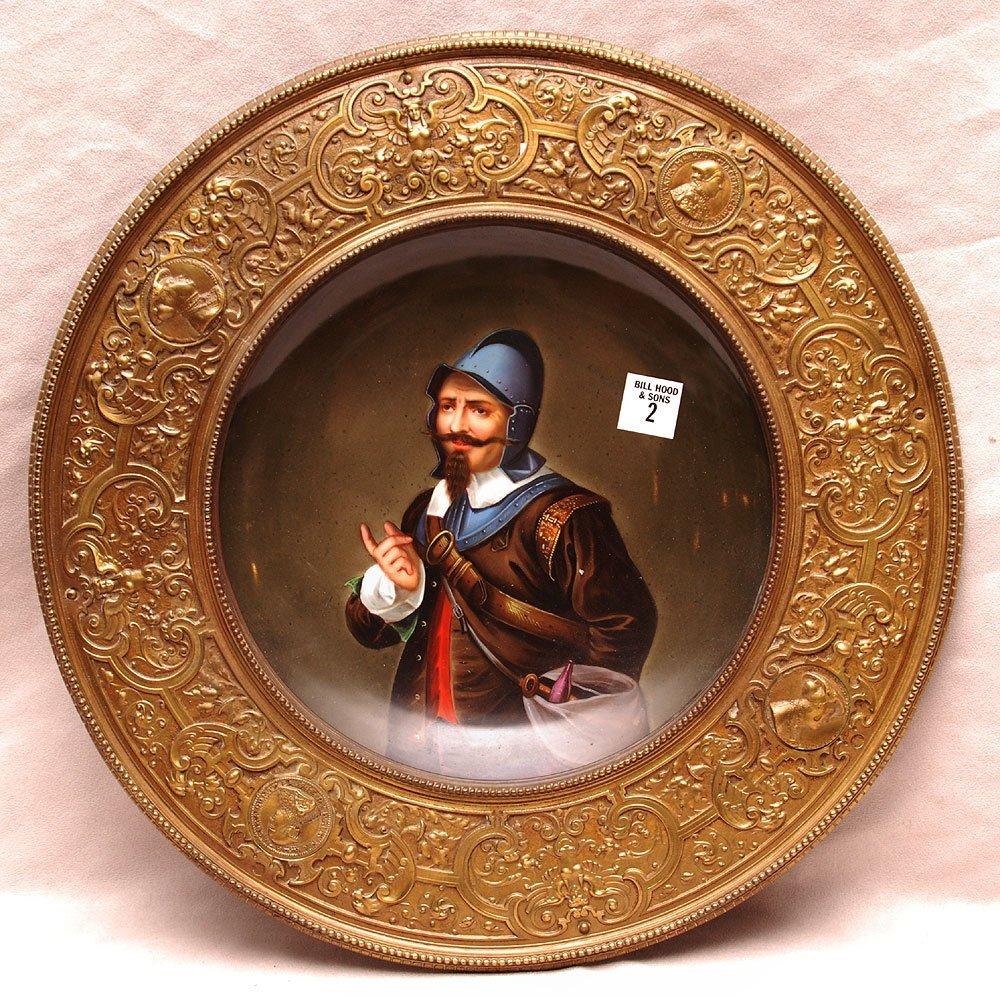 Portrait plate of medieval gentleman in bronze frame, p