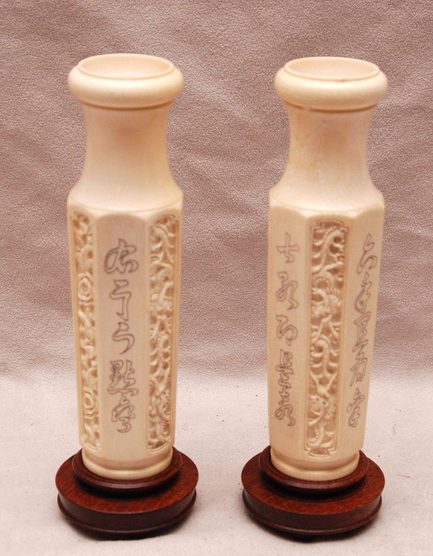 "Pair of ivory vases, 7""h"