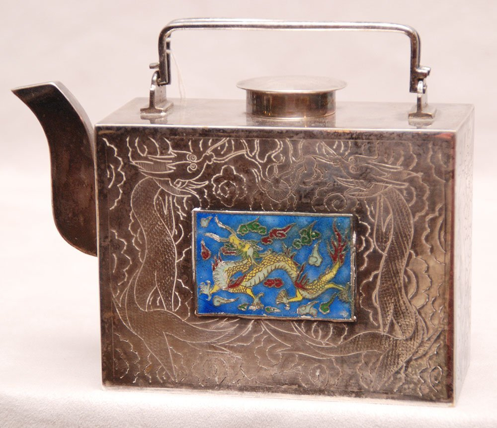 Chinese silvered teapot, flat sided embossed around wit
