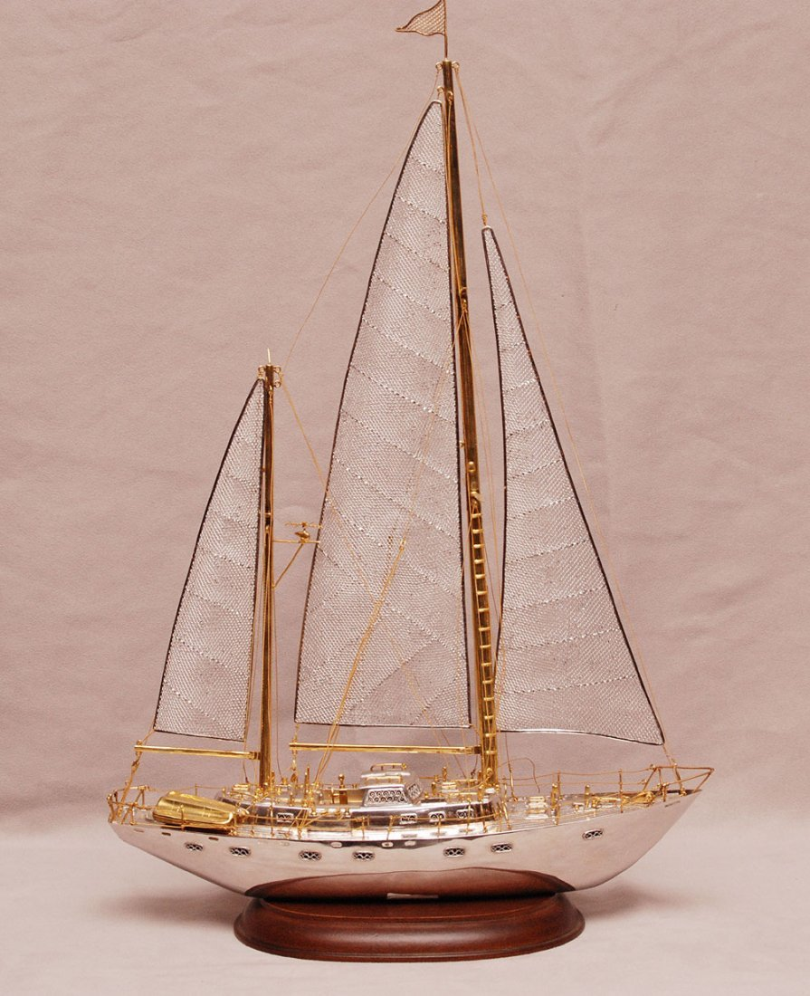 Sterling silver sailboat with gold colored accents, woo