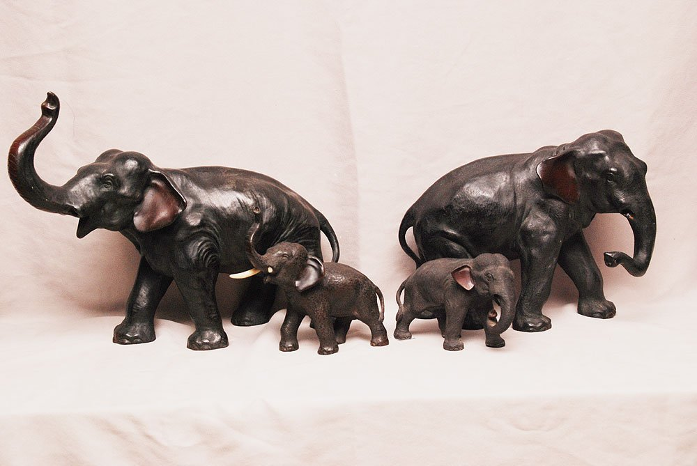 "Family lot of 4 bronze elephants, largest 13""h x 17""w"