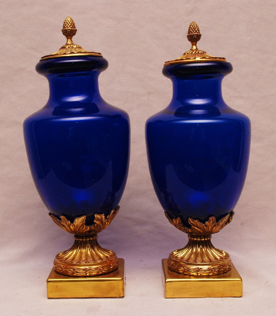 Pair of cobalt glass covered urns with bronze mounts an