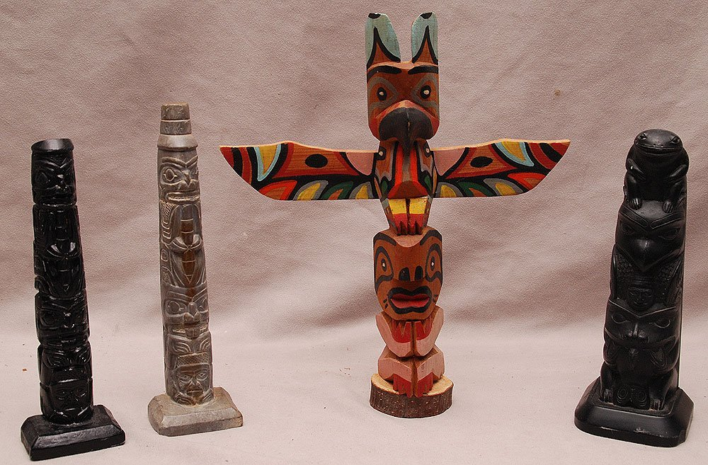 Set of 4 Northwest Totem Poles. One cedar, inscribed on