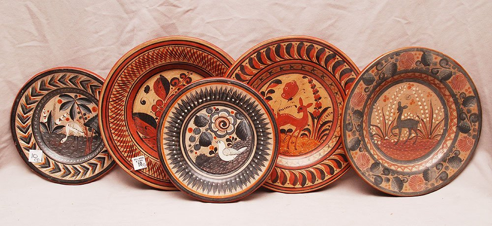 "Five assorted Mexican pottery plates, (3) 12 1/4"" plate"