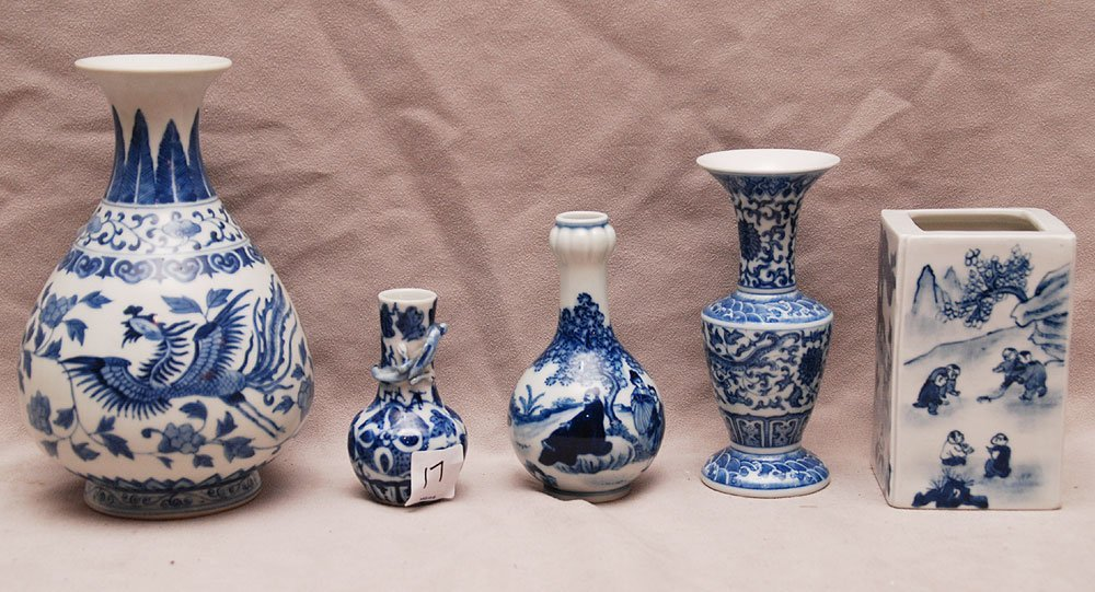 5 small blue and white vases and bud vases